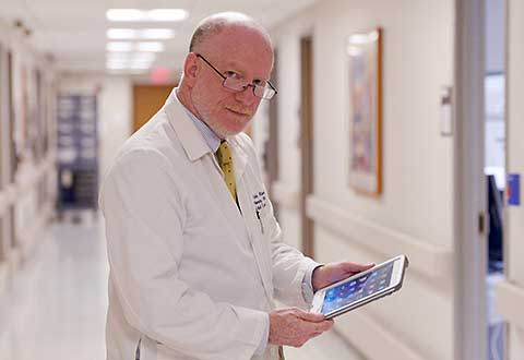 Dr. Charles Atwood can now access patient information anywhere with his new iPad.